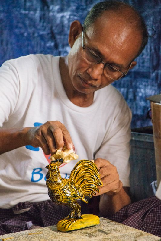 Artisan applying gold leaf