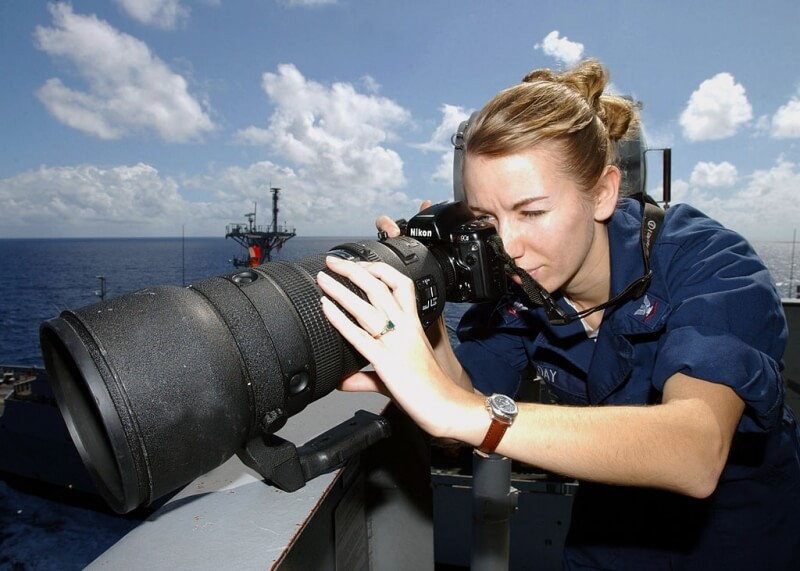 US Navy member Sabrina Day uses this giant 400mm fixed telephoto lens aboard an aircraft carrier.