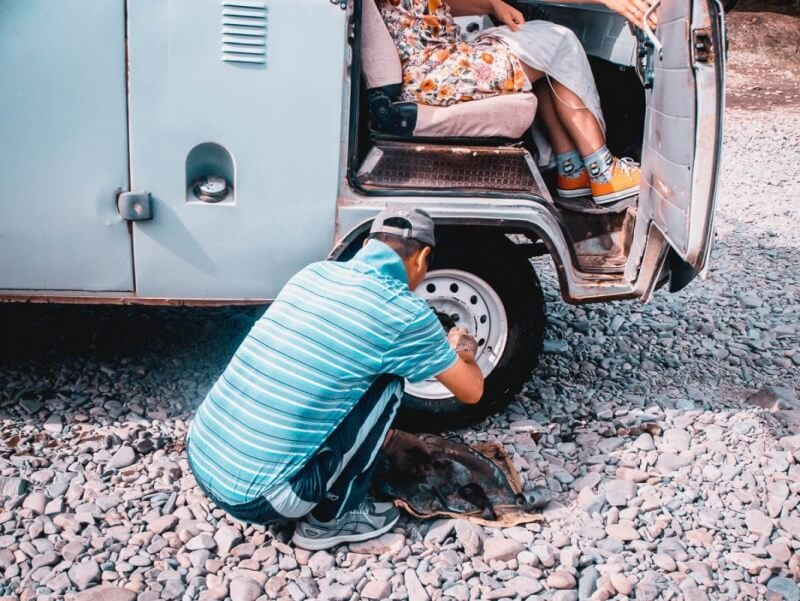 Driver fixing russian van